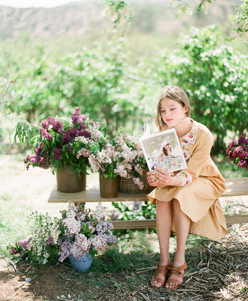 reading Flutter Magazine in the flowers